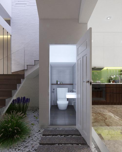 Phòng vệ sinh phân chia ranh giới giữa phòng khách và phòng bếp